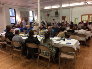 2017 Passover Rabbi and full room
